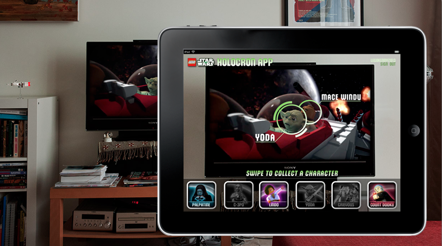 An example of the kind of Second-Screen interactions might be included in the Holocron app. Here, we see a game in which you hold the iPad in front of the screen and swipe different character's faces to collect them in your Holocron, unlocking information and trivia as the show proceeds. Much of the information and trivia are new to the Star Wars mythology and are revealed during the episode being aired.